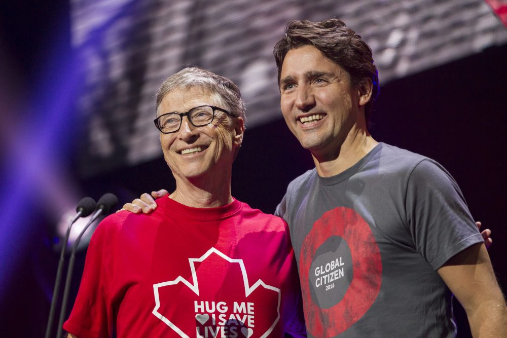Billionaire philanthropist Bill Gates receives a hug from Canadian Prime Minister Justin Trudeau at the Global Citizen Concert to End AIDS, Tuberculosis and Malaria in Montreal, Quebec, September 17, 2016.  AFP Photo/ POOL/ Geoff Robins